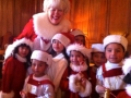 Mrs Claus with little elves